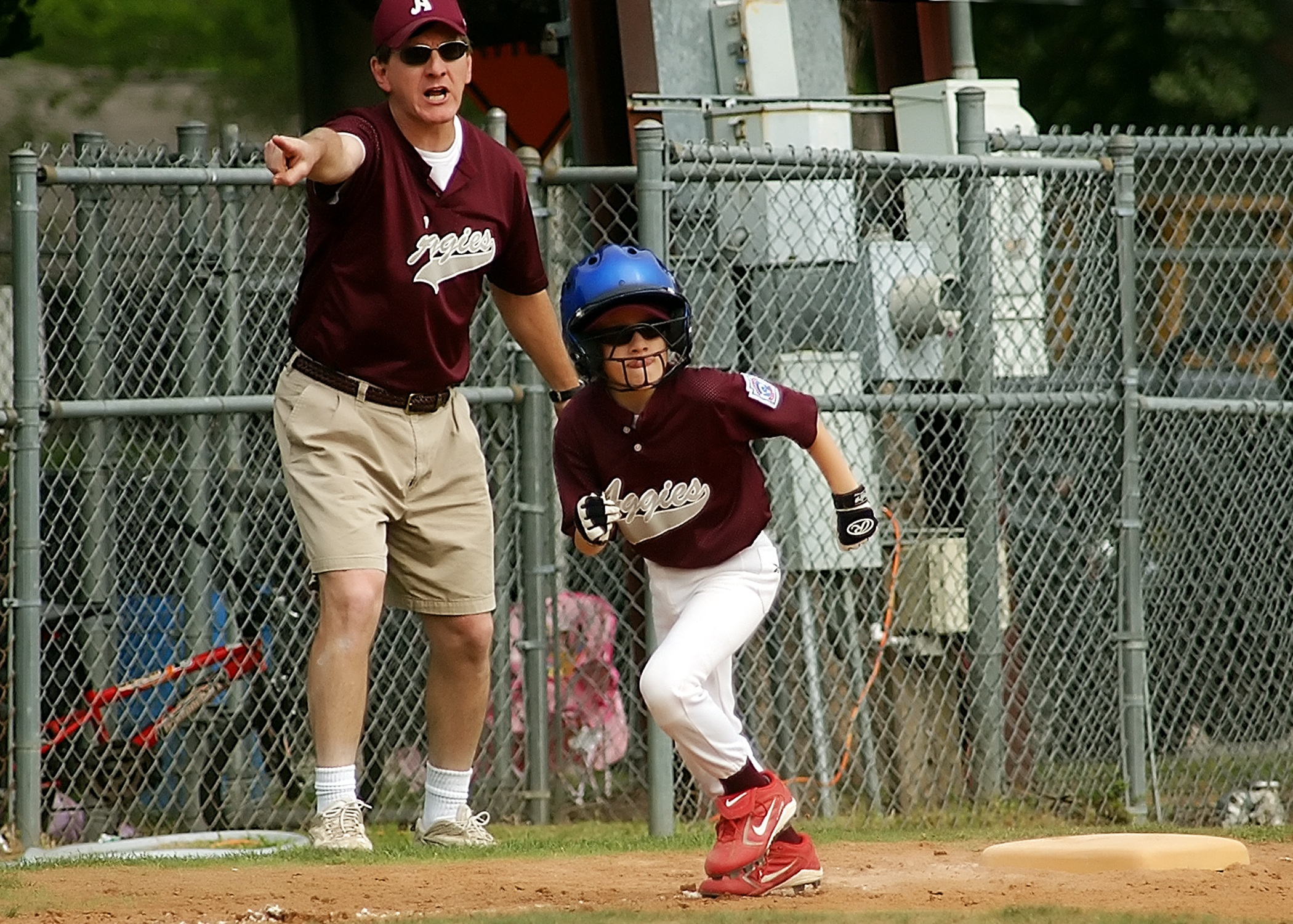 Baseball player running between bases in agame