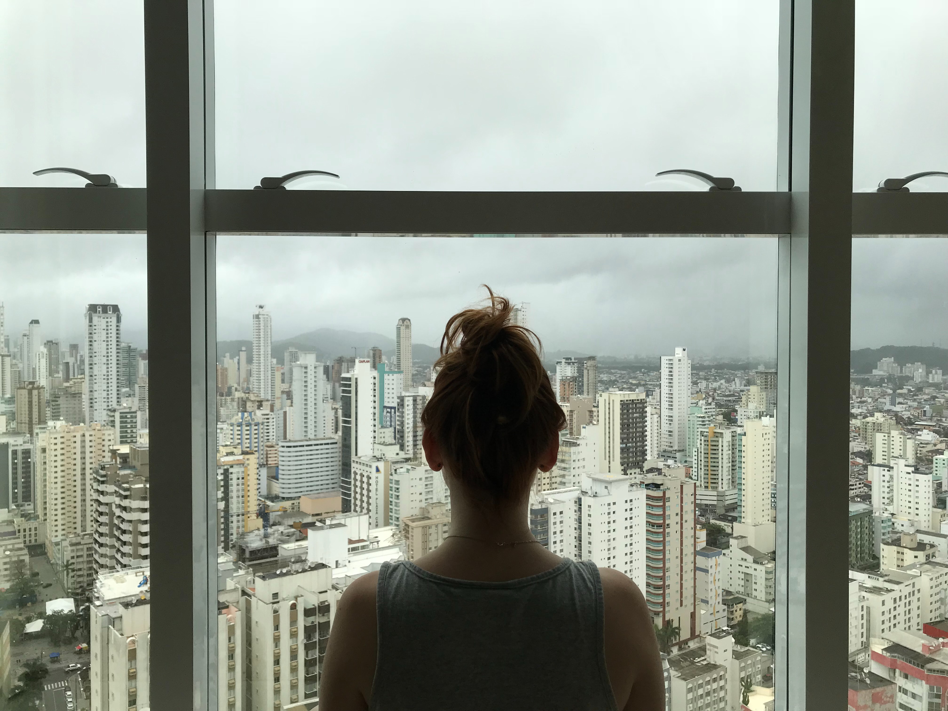 Women looking at a city skyline