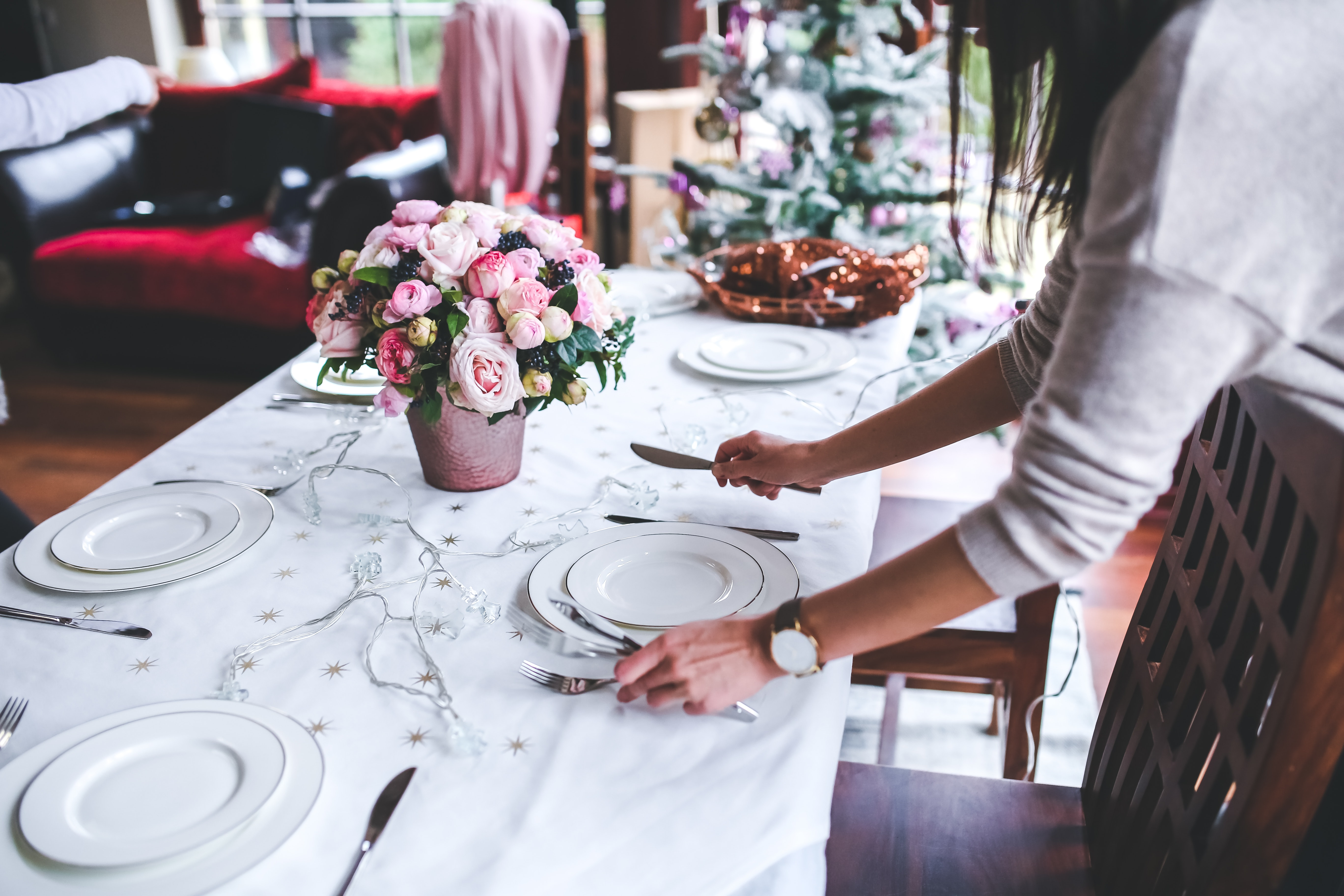 Women decorating table place settings