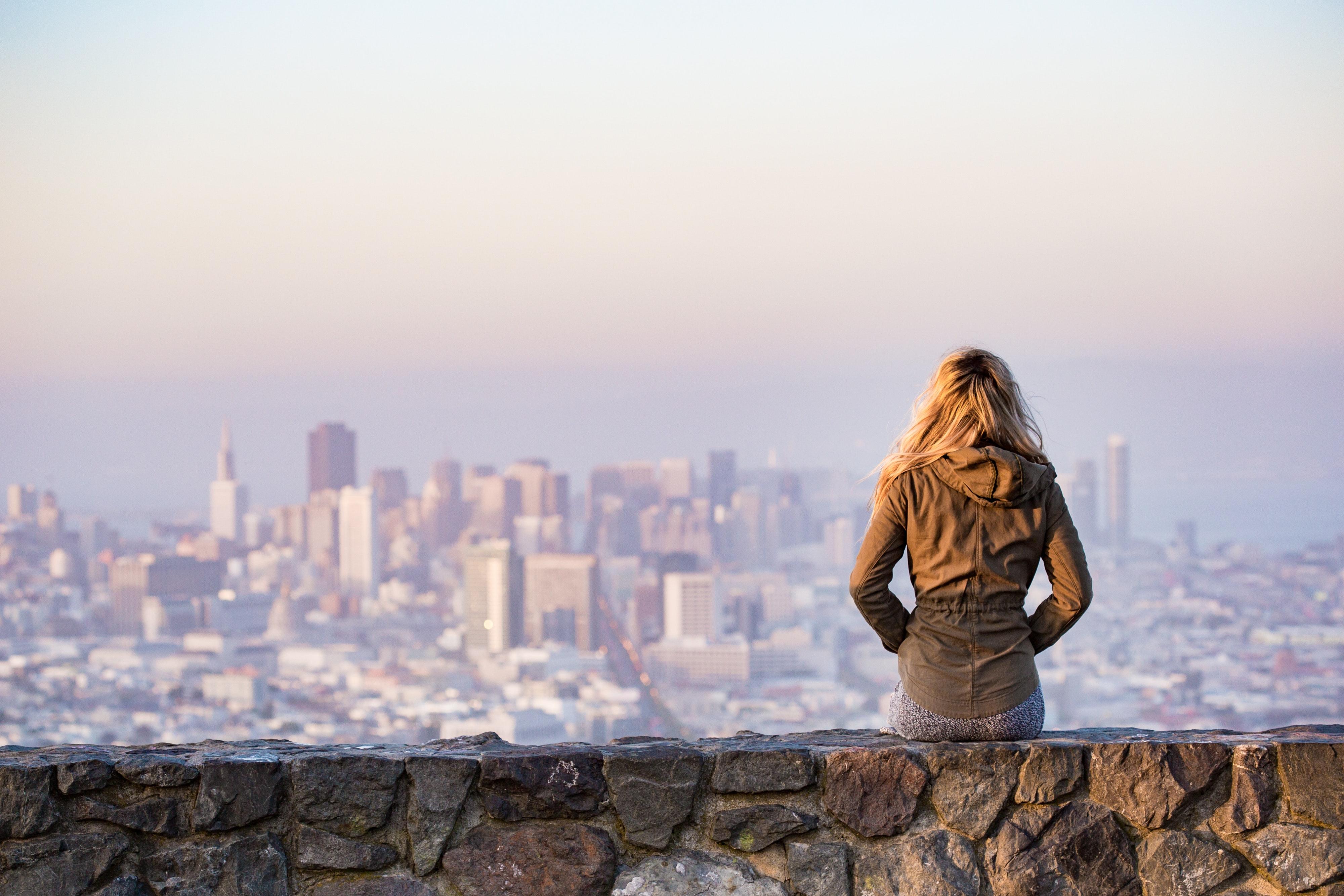 Women viewing city skyline