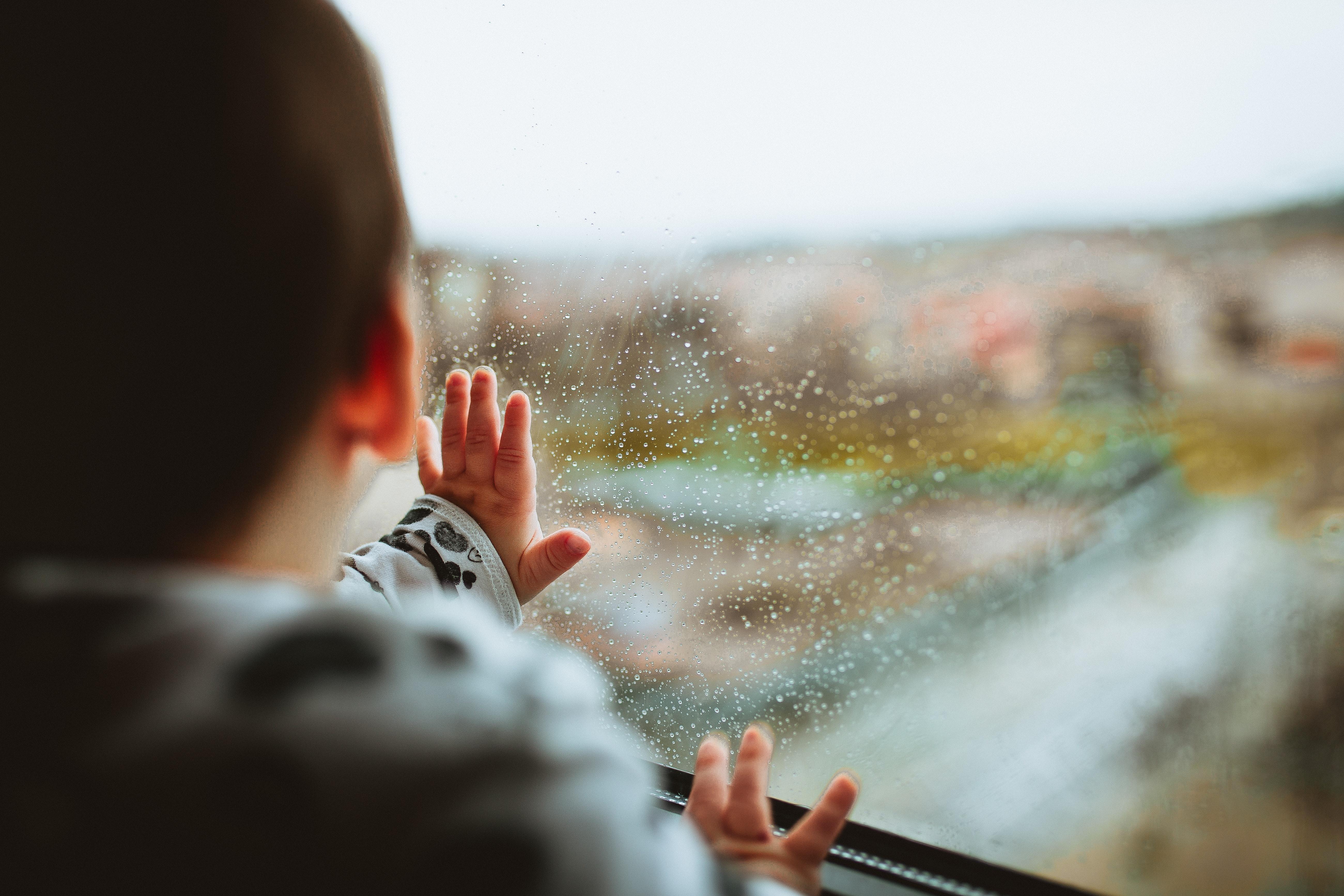 Child viewing city skyline