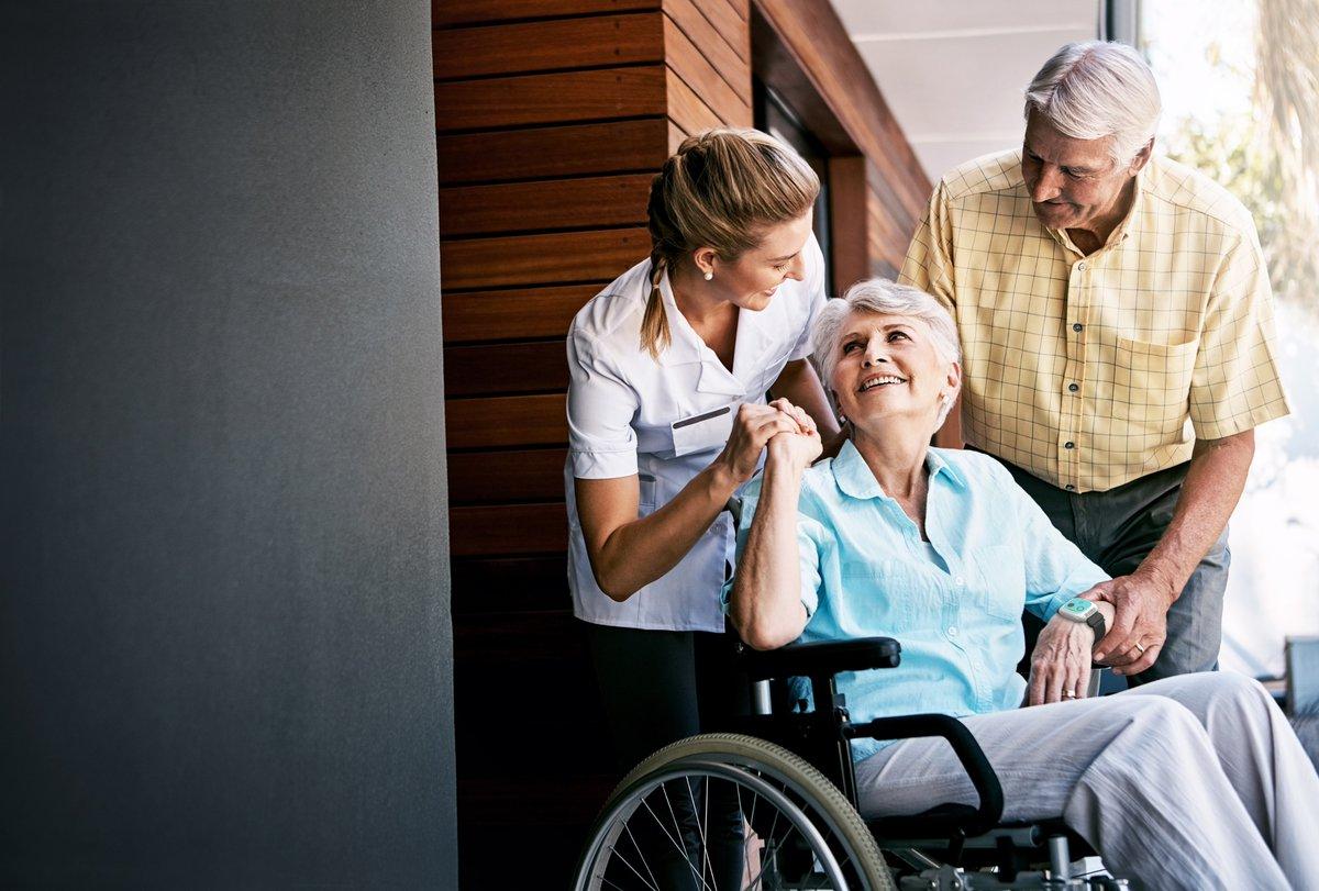Nurse caring for elderly patient in w